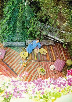 Yves Saint Laurent relaxing in his garden in Marrakech, Morocco in 1980