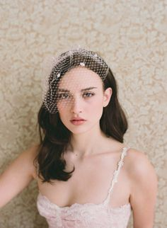 Bridal birdcage veil  Mini birdcage veil with dots  by myrakim, $70.00    I love he makeup especially. I would want this with a cat eye
