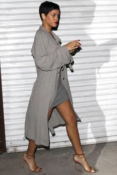 Rihanna IN COAT 2014 | She cut an elegant figure with bright red lips that matched her ...