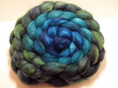 Still Waters BFL/Tussah 85/15 5oz from Corgi Hill Farm. Great transition from the dark great to the dark blue.