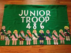 Girl Scouts Banner...cute idea for the girls to create their own little self portrait for the banner.