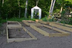 Raised beds for a sloped yard. Interesting blog about the beds and planting.
