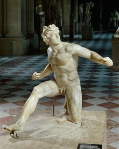 "Statue of a wounded Galatian, Lesser Attalid, So-called ""kneeling youthful Gaul"", Alabaster, Left hand and right arm are modern restorations, Greek sculptors hired during Roman Imperial period to copy (first-second century AD) after a Greek original. Louvre Museum"