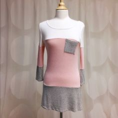Light weight pink tunic top Light weight Pink and grey tunic top. This listing is for SMALL. There are another listing for M and L. True to size Bundle 2 or more for 15% off April Spirit Tops Tunics