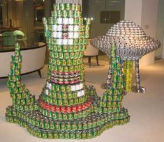 Canstruction artwork is fun modern art which employs cans for creating stunning artwork. Gallery of 65 best award winning examples of canstruction sculpturing Bottle Display, Pop Display, Visual Display, Display Ideas, Market Displays, Merchandising Displays, Store Displays, Food Humor, Funny Food