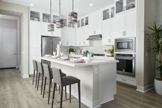 We used cabinets with glass doors on the top tier to create a beautiful display opportunity for favorite pieces (high and away from the kiddos). They also break up the monotony of the ample storage in here!  Revo Plan One at Novel Park for William Lyon Homes #ChameleonOC #ChameleonDesign #ChameleonDesignOC #Kitchen #KitchenDesign #KitchenInspiration Glass Cabinet Doors, Glass Doors, Used Cabinets, Design Awards, Hgtv, Opportunity, Kitchen Design, New Homes