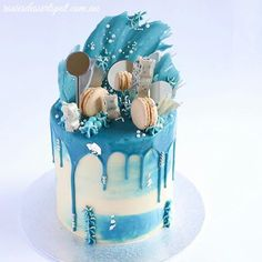 Blue, white and silver loaded drip cake