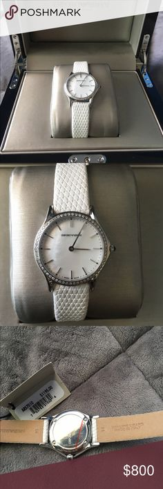 Armani Swiss made watch Genuine white lizard leather Armani watch. Armani swiss made collection. Complete with case, box, owners manual, authenticity card and Armani watch pouch. Originally this is a $1600 dollar watch. I bought it for $1200 plus tax. I'm open to reasonable and respectful offers Emporio Armani Jewelry