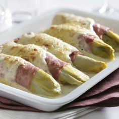 Belgian endive with ham and cheese  We had to use muenster, but it was still great