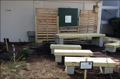 A high school student designed this as an outdoor classroom for her town's elementary school. Clever use of the Pallets!!