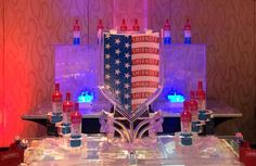 Double wide, two track ice luge with a color filled crest and twin three tier bottle holders for Smirnoff. #iceluges