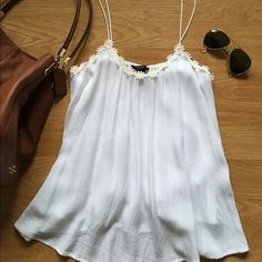 NWOT Forever 21 Festival Daisy White Tank Top NWOT White Festival Daisy Tank Top from F21! Lined, Daisy flower trim, unadjustable spaghetti straps. Very cute and flowy! No trades. Offers are welcomed!!! Forever 21 Tops Tank Tops