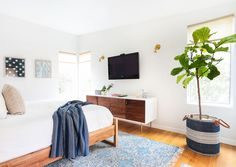 """About the master bedroom, Haley says, """"To contrast the bright playfulness of the entire house the client Leslie wanted their bedroom to be an oasis. I loved the peacefulness of the space. Very important for parents of two young kids!"""""""