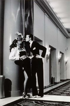 Editorial by photographer Helmut Newton for March 1979 French Vogue, with Gia Carangi (left) and Robin Osler (right, who is also a woman). They wear Yves Saint Laurent, the fashion designer, in his.