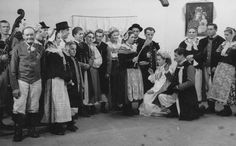 Folk costumes from Szamotuły, west-central Poland - bride and groom kneeling before parents. Archival photo [source].