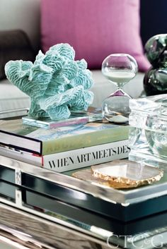 A tray on the coffee table in the living room holds the client's books and treasures. #CTC&G