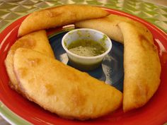 Venezuelan empanadas; they make them with all kinds of fillings from shark to chicken to shredded meat or just cheese! Yum!