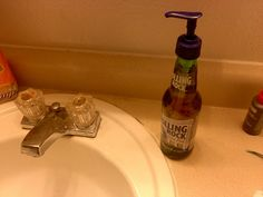 Beer Bottle Soap Dispenser... Thinking about making one for my boyfriend, and my mom, for Christmas.