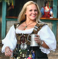 Lovely Lady at Faire. I'm always in love with how much STUFF someone can carry on their belts...tried it last year and it was a pain. Need to get a good big pouch.