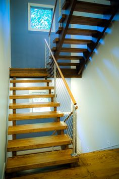 Our cable railing systems give your stairs a distinct modern touch. Expertly installed, they lend a unique beauty to your stairs. Wood Stair Treads, Wood Stairs, Basement Stairs, Modern Staircase, Staircase Design, Stairs Canopy, Cantilever Stairs, Bathroom Under Stairs, Open Stairs