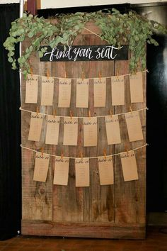 Rustic Greenery Wedding Seating Arrangement Chart // escort cards