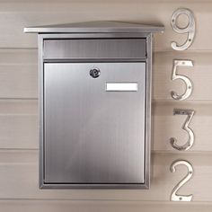 Home Locking Wall Mount Mailbox - Stainless Steel by Maycreek. $69.95. The Home Locking Wall Mount Stainless Steel Mailbox features a peaked roofline and a front letter slot. This sleek mailbox will coordinate with any home's decor. Made of 304 stainless steel and is resistant to corrosion, making it ideal for areas with salt water nearby. Overall dimensions: 12-1/4 L x 4 W (front to back) x 15-1/4 H (± 1/2 ). Letter slot dimensions: 8-5/8 L x 1 H. Customizable ...