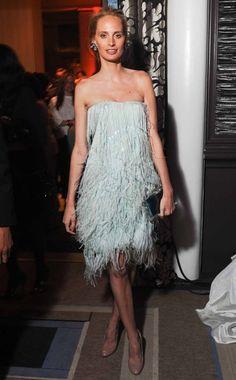 A perfectly styled Lauren Santo Domingo wearing a powder blue Oscar de la Renta feathered party dress What: Oscar de la Renta