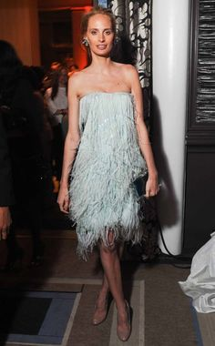 A perfectly styled Lauren Santo Domingo wearing a powder blue Oscar de la Renta feathered party dress                                                                                                                                                                                                                                    What:                                                          Oscar de la Renta