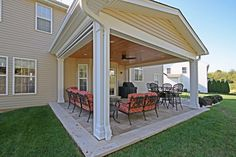The family now walks out from the family room onto a two-level covered patio.
