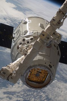 Dragon grappled by Canadarm2 With the blackness... | The Dark Side of the Force