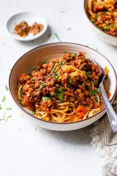 This easy LENTIL BOLOGNESE recipe is a quick weeknight meal that just so happens to be vegan and gluten free. It's filled with flavor and a great way to switch up pasta, plus it comes together in under 30 minutes! #lentils #lentilbolognese #vegan