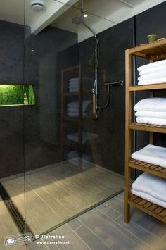 tadelakt walls, full drain at end of shower, glass wall