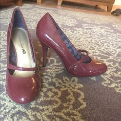 Faux patent leather pumps Faux patent leather Mary Jane style pumps. Only worn once or twice. They have a few scratches, but overall in great condition. American Eagle by Payless Shoes Heels
