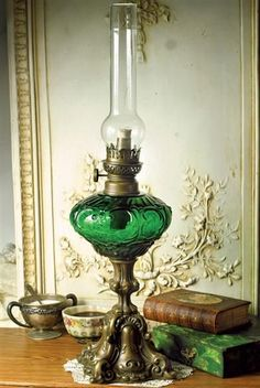 "Tierney Oil Lamp | Modeled after a coveted family heirloom, this exquisite replica of emerald green will cast a dreamy ambience upon your evenings at home. Italian brass. Simply Assembly. 28""."