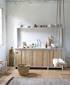 Wooden doors with a barcode to structure this sideboard, but it can also serve as a kitchen. And to top it off, a nice swing on a beam | Styling Marianne Luning | Photographer Anna de Leeuw | vtwonen juli 2015