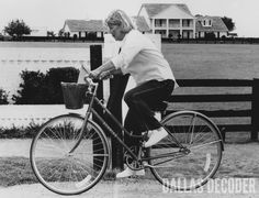 """Miss Ellie (Barbara Bel Geddes) bikes home after retrieving the mail in this 1981 publicity shot from """"The Split,"""" a fifth-season """"Dallas"""" episode. Relive more memories at DallasDecoder.com."""