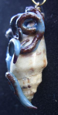 Questionable creature pendant by uniqueeuphoria on Etsy,