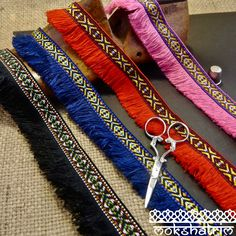 Scandi tribal jacquard trim with thread fringe in black red, blue and pink. Width: (Jacquard Fringe Mokshatrim Exotic Haberdashery from around the world. Fringe Trim, Haberdashery, Ribbon, Lace, Red, Pink, Things To Sell, Ethnic, Products