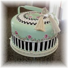 Painted old aluminum cake carrier.  I have never seen one like this - have a cousin who loves green and pink - would be her cup of tea