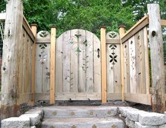 adding whimsy with a recycled cedar art fence & gate, creative art on the steps