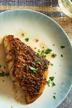 "NYT Cooking: A blast of heat in a cast-iron pan and a basting of golden butter does wonders for plain fish fillets. This life-changing method is adopted from a former chef and current fishmonger, Mark Usewicz of Mermaid's Garden in Brooklyn, who also teaches cooking classes in topics like ""How to Cook Fish in a New York City Apartment."" The cooking time is so short that the sme..."
