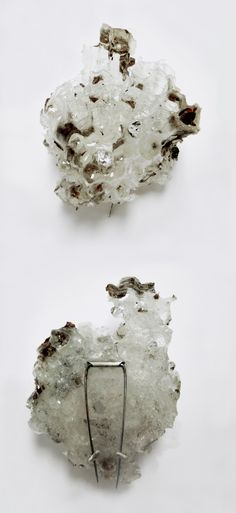 """Julia Elizabeth Louise Morris--Nests  2011, 2012  – Resin Paper Wasp Nests  """"Nests"""" are cast resin brooches made from molds of found paper wasp nests. Cubic zirconia stones are suspended in the cells of the nests, and a sterling silver and spring steel pin back is set into the back of the brooch."""