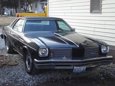 1975 Olds Cutlass Salon black on black. 1st car, (not this one) brings back memories.
