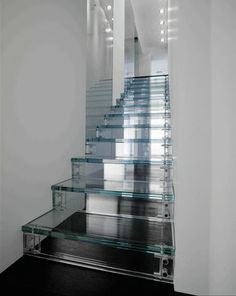 Glass stairs. Great idea to increase light in an infill or similar, but probably horrible to keep clean! Still an interesting idea.