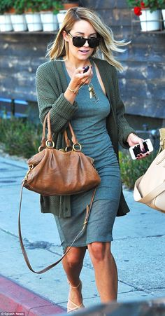 Green goddess: She wore the same outfit – a bluish green dress – and necklace seen in the ...