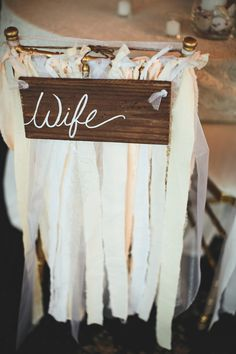 Adorable sign and decoration for the bride and groom's chairs at the reception. <3