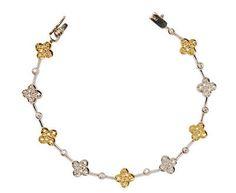 White & Yellow Diamond Clover Bracelet Clover Link Design Colorless & Fancy Yellow Diamonds, .97 Carats Total Weight Bead & Bezel Set Diamonds  18K Yellow, White Gold Price: $7,250 REF#: MPC 250-10715