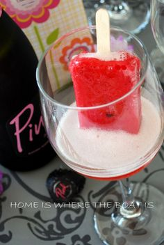 A frozen fruit bar served  with a splash of Pink Sparkling Wine~