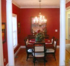 Red and White Wall Color for Dining Room Decorating with Amazing Brown Wood Rectangle Shaped Dining Table on the Solid Wood Flooring and Simple Dining Chairs that have White Seat Cushions also Luxury Chandelier
