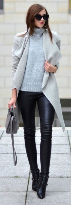 Leather leggings are a must have this fall. Wear yours with knitwear to get that cosy, festive vibe. Via Barbora Ondrackova.   Knit/Coat: Zara, Leggings: Balenciaga, Boots: Valentino, Bag: Saint Laurent.